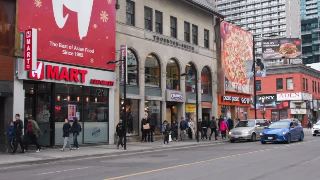 toronto, canada, walking in yonge street during the day - ontario canada stock videos & royalty-free footage