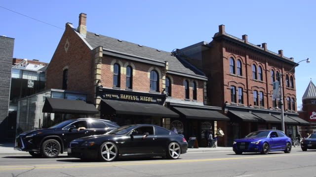 toronto, canada: yonge street italianate commercial style building - brick stock videos & royalty-free footage