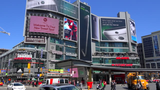 toronto, canada: yonge-dundas square, everyday lifestyle in the downtown district of the canadian city - electronic billboard stock videos and b-roll footage