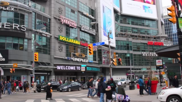 toronto, canada, yonge-dundas square, panning left - ontario canada stock videos & royalty-free footage