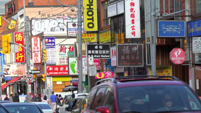 toronto, canada: zoom in to the business signs in chinatown - local landmark stock videos and b-roll footage