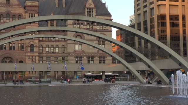 toronto canada: zoom out from the old city hall to nathan phillips square - revival stock videos & royalty-free footage
