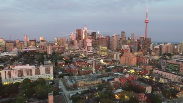 toronto city at dusk viewed from aerial drone video - toronto bildbanksvideor och videomaterial från bakom kulisserna