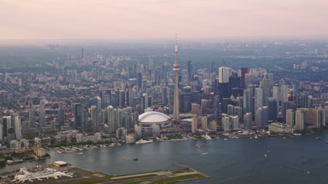 aerial toronto from the inner harbour on lake ontario, canada - ontario canada stock videos & royalty-free footage