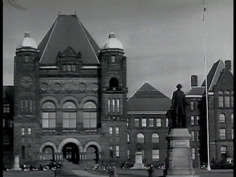 Toronto Legislative Assembly building w/ statue FG Toronto downtown street scene w/ electric trolley passing FG