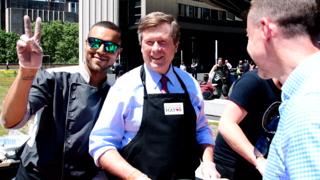 Toronto Mayor John Tory serves food during the launch of Pride Month at new City Hall Toronto celebrates for the first time a full month of Pride...