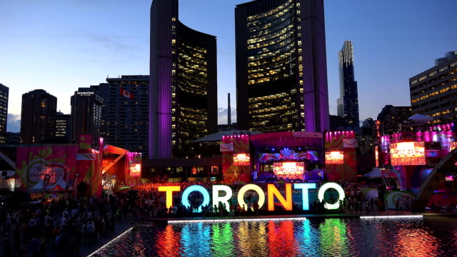 toronto nathan phillips square is the main stage of panamania the cultural festival that happens along the pan american games / the landmark has been... - パンアメリカンハイウェイ点の映像素材/bロール