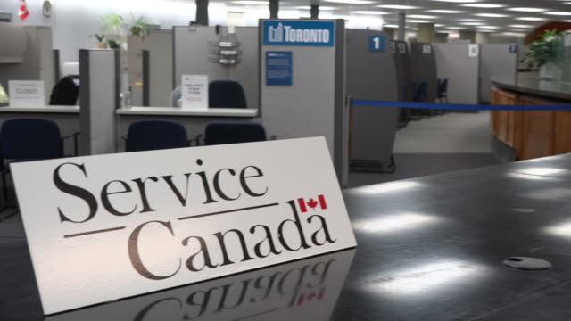 toronto, ontario, canada, a sign for service canada which is a government-run institution to help citizens, residents, and immigrants navigate the... - emigration and immigration stock videos & royalty-free footage