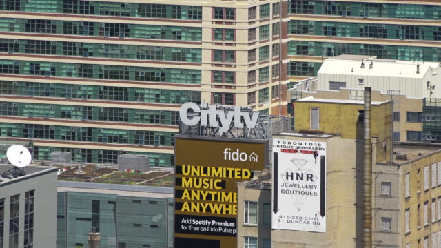 toronto ontario canada zoom out from the buildings in the downtown district during the daytime they are part of the dundas square there... - ontario canada stock videos & royalty-free footage