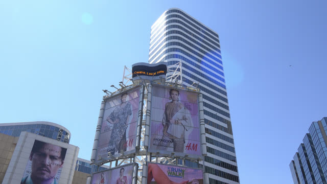 toronto, ontario, canada-april 10, 2014: tilt-up of the buildings surrounding the yonge-dundas square which are covered in commercial advertisement... - lens flare stock videos & royalty-free footage