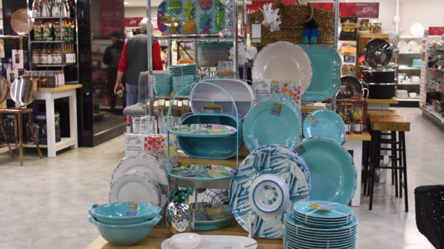 beautiful blue plastic kitchen utensils for sale at a winners store in the downtown district the image is a point of view of the retail business... - large group of objects stock videos & royalty-free footage