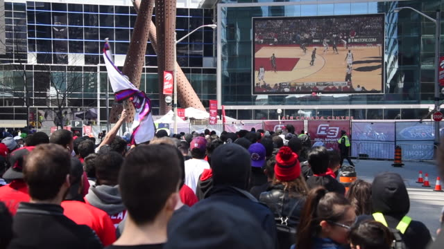 toronto, ontario, canada-april 16, 2016: the toronto raptor's fans are seen outside of the air canada centre where a large screen displays the game... - playoffs stock videos & royalty-free footage