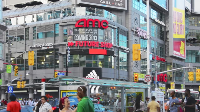 stockvideo's en b-roll-footage met toronto ontario canadacirca august 2013 establishing shot of the business signs and people in the yongedundas square yongedundas square is located in... - 2013