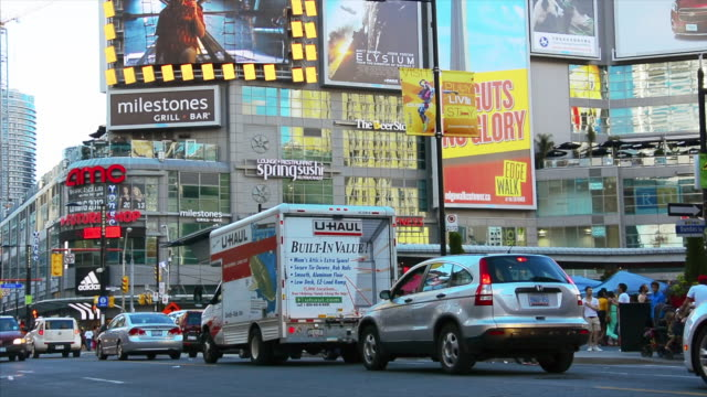stockvideo's en b-roll-footage met toronto ontario canadacirca august 2013 tilt down from the business signs at yongedundas square yongedundas square is located in the downtown... - 2013