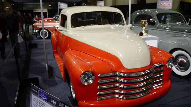 toronto, ontario, canada-february 19, 2014: a cream and orange-color classic car that has won the gold medal in the vintage cars section. the 2014... - orange colour stock videos & royalty-free footage