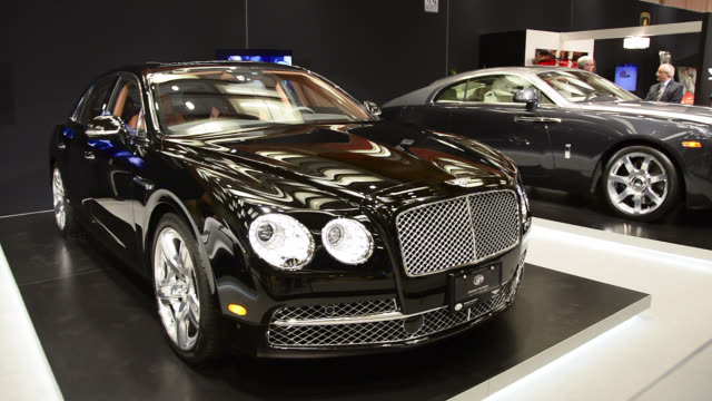 toronto, ontario, canada-february 19, 2014: the bentley pavillion exhibits a black bentley car. the canadian international auto show is a traditional... - 2014 stock-videos und b-roll-filmmaterial
