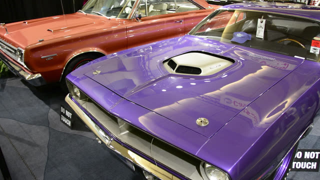 vidéos et rushes de toronto, ontario, canada-february 22, 2014: two beautiful vintage cars are seen in the corresponding pavilion. the canadian international auto show... - 2014