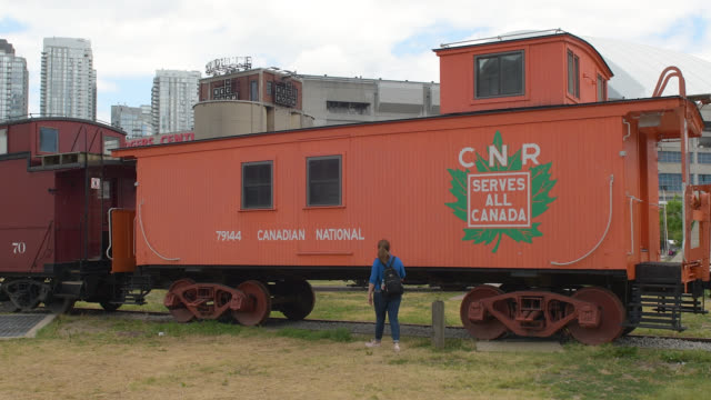 toronto, ontario, canada-july 15, 2020: heritage caboose car belonging to the canadian national railways. a tourist walks in the open-air and free... - local landmark stock videos & royalty-free footage