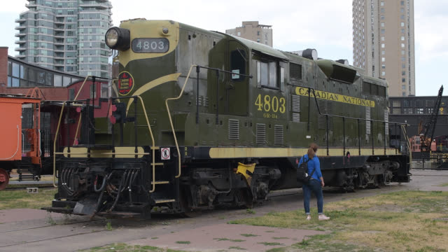 toronto, ontario, canada-july 15, 2020: heritage locomotive belonging to the canadian national railways. a tourist walks in the open-air and free... - local landmark stock videos & royalty-free footage