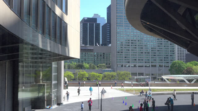 toronto, ontario, canada-july 7, 2017: establishing shot of the nathan phillips square from inside of the city hall. the area is a local landmark and... - local landmark stock videos & royalty-free footage