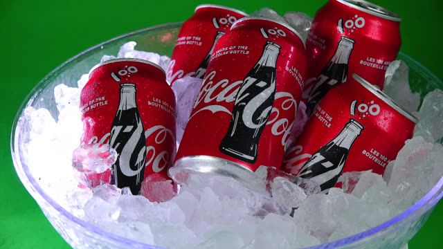 toronto, ontario, canada-june 28, 2017: in this illustrative editorial video clip, cans of original coca-cola carbonated drink are seen in ice and... - editorial stock videos & royalty-free footage