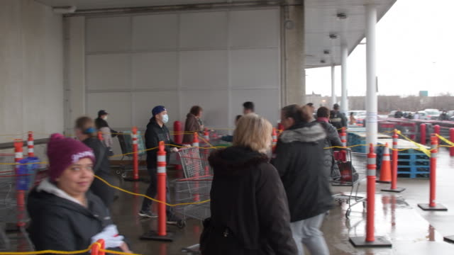 toronto, ontario, canada-march 20, 2020: people keep social distance as they line up at a costco store to buy supplies during the coronavirus... - self discipline stock videos & royalty-free footage