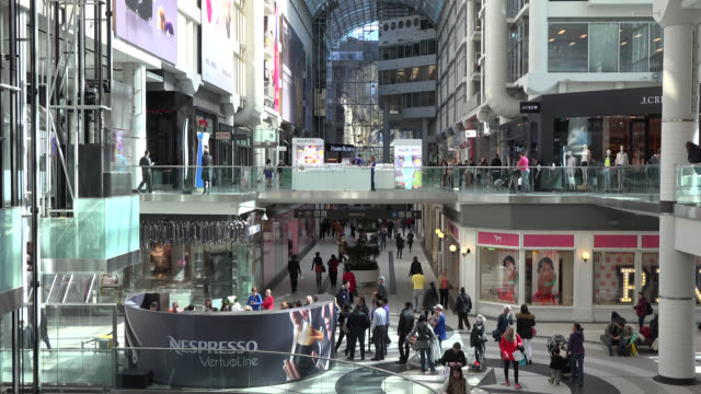 vídeos y material grabado en eventos de stock de toronto, ontario, canada-may 02, 2014: tilt-up to a nespresso kiosk inside of the famous place. the image shows the architecture and the lifestyle in... - lugar famoso local