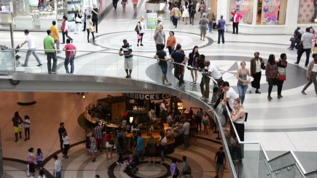 toronto, ontario, canada-may 20, 2015: establishing shot of the eaton centre with lots of people moving in the scene. the place is located close to... - luogo d'interesse locale video stock e b–roll
