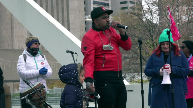 toronto ontario canadanovember 9 2019 rap artist and child singing to the demonstrators unifor and the ontario health alliance plus about twelve more... - unity stock videos & royalty-free footage