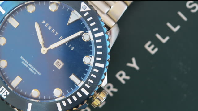 toronto, ontario, canada-october 16, 2019: editorial illustration of a perry ellis watch rotating on a display. the beautiful men's watch has a blue... - macro stock videos & royalty-free footage