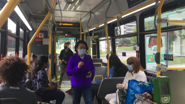 toronto, ontario, canada-september 20, 2020: real people wearing protective face coverings inside of a ttc or toronto transit commission bus. during... - epidemiology stock videos & royalty-free footage