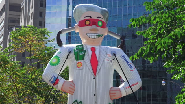 toronto, ontario, canada-september 27, 2019: an inflatable large doll representing the oil companies and the greed for money. thousands of people... - representing stock videos & royalty-free footage