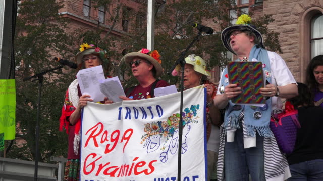 toronto, ontario, canada-september 27, 2019: toronto raging grannies performs a song in the stage set in front of the provincial government building.... - climate stock videos & royalty-free footage