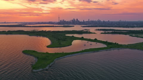 aerial toronto, ontario from outer harbour at sunset - dramatic sky stock videos & royalty-free footage