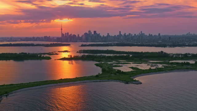 aerial toronto, ontario lit by the golden light of the sunset - ontario canada stock videos & royalty-free footage
