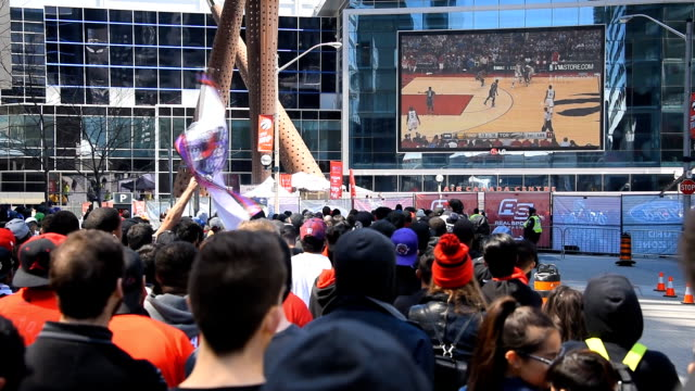 toronto raptors fans gathered outside the air canada centre to watch on big screen the first game of the 2016 nba play off where their team is... - playoffs stock videos & royalty-free footage
