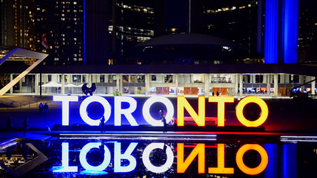 toronto sign in nathan phillips square at night - toronto stock videos & royalty-free footage