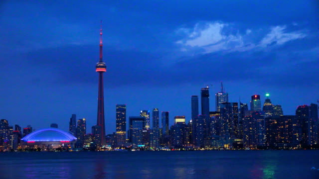 Toronto skyline establishing shot at night including the CN Tower, Canada