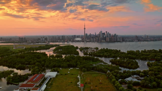 aerial toronto skyline from the toronto islands at sunset - famous place stock videos & royalty-free footage