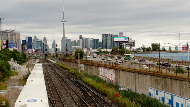toronto skyline overlooking gardiner expressway and railway tracks – day, wide shot - spoonfilm stock-videos und b-roll-filmmaterial