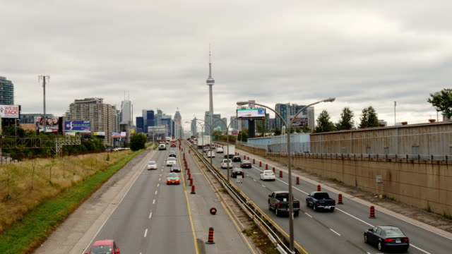 toronto skyline overlooking gardiner expressway – day, wide shot - spoonfilm stock-videos und b-roll-filmmaterial