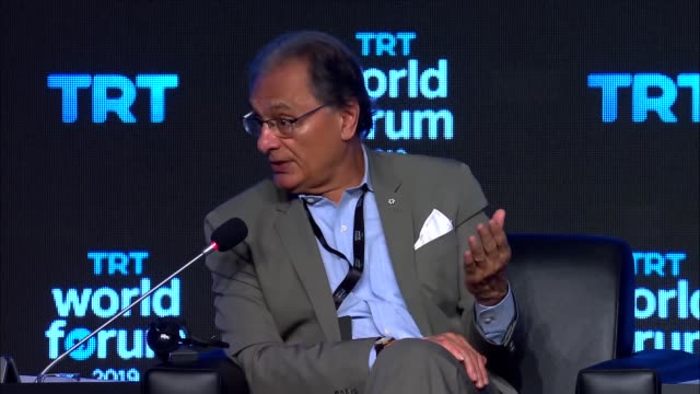 toronto star's columnist haroon siddiqui and member of british house of lords lord richard balfe attend the trt world forum running under main theme... - columnist stock videos & royalty-free footage