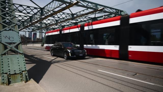 toronto streetcar - train vehicle stock-videos und b-roll-filmmaterial