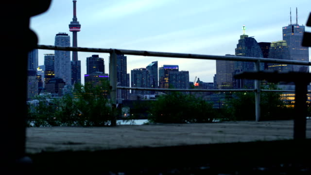 toronto sunset over lake panorama with cn tower, urban skyline. - waterfront stock videos & royalty-free footage