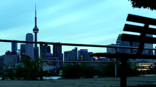 toronto sunset over lake panorama with cn tower, urban skyline. - toronto stock videos & royalty-free footage