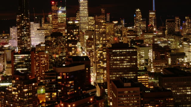 toronto urban skyline at night. time lapse, medium wide - spoonfilm stock-videos und b-roll-filmmaterial