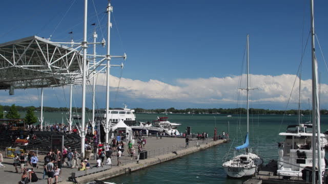Toronto,Canada: aerial view waterfront harbourfront with main stage and marina. Real people in recreational pursuit on a beautiful Summer weather day.