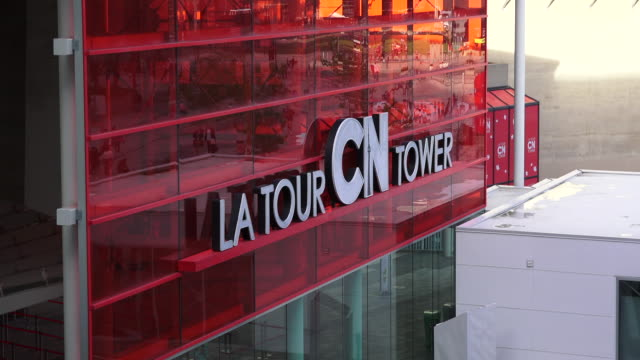 toronto,canada: cn tower entrance sign, zoom in. the landmark is a major tourist attraction in the downtown district of the capital city of ontario province - entrance sign stock videos & royalty-free footage