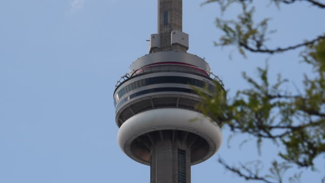 Toronto,Canada: CN tower main pod in blue clear day. The communication tower and famous place tourist attraction is visited every year by millions of visitors to the Canadian city
