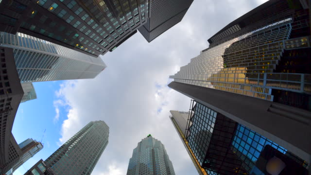 toronto,canada: financial district time lapse of clouds moving over the skyscrapers. low angle view at the royal bank plaza in the canadian city - royal bank plaza stock videos & royalty-free footage